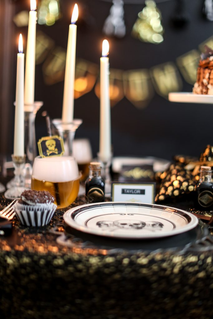 set the stage for an elegant halloween evening glittered tablecloths candle lit table and coordinating delicious treats all with a grown up flair will